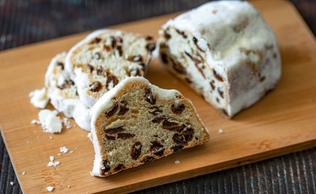 Christmas stollen on a plate dark background