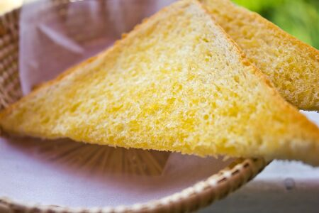 Buttered toast in a basket.