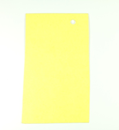 yellow paper on white background photo