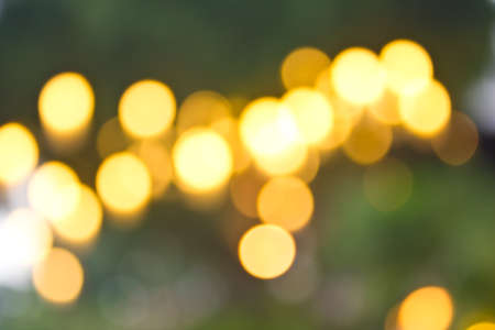 Abstract  bokeh on yellow background photo