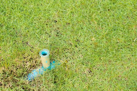 local supply: Old blue pipe on garden