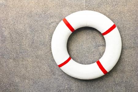 emergency vest: life jacket on a wall Stock Photo
