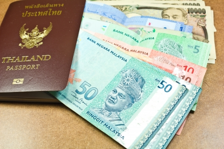 Thailand passport and ringgit malaysia, yen japan Stock Photo