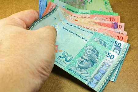 hand holding a money ringgit malaysia