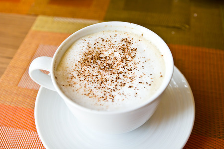 Coffee hot cappuccino in cup photo