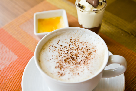 Coffee hot cappuccino in cup and dessert photo