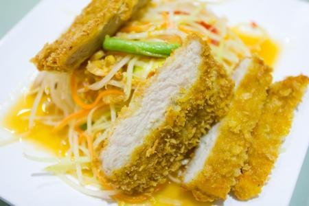 thai green papaya salad with fried pork Stock Photo