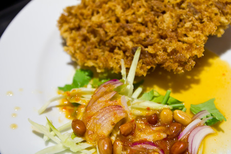 Crispy catfish spicy salad , thai food photo