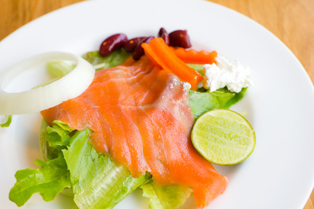 smoked salmon with vegetables, salad photo