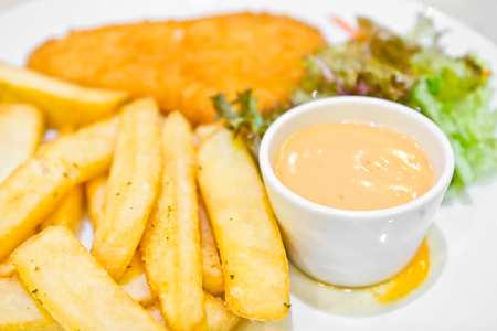 Fish and chips with dip sauce photo