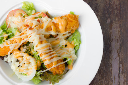 fried shrimp salad with sauce photo