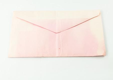 old envelope: old Pink money envelope on white background