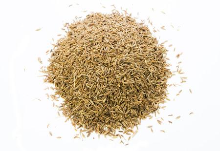 Cumin Seeds on white background Stock Photo