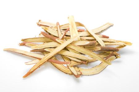Slice liquorice roots on white background