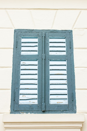 old green window on the wall