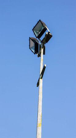 halogen lighting: light pole on blue sky