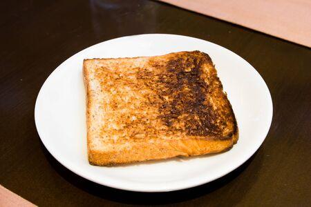 burnt toast: sandwich bread over burn on dish