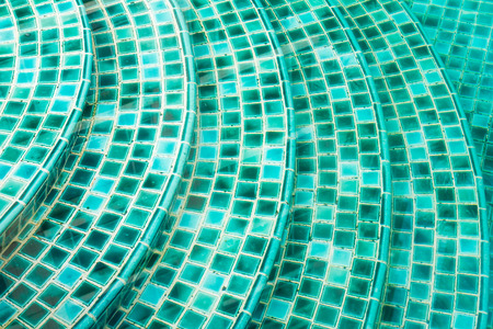 Small green tiles texture in swimming pools photo