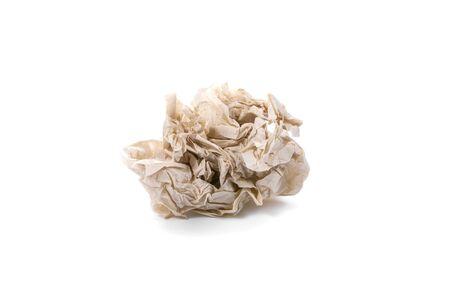 ball lump: Crumpled brown napkin on white background