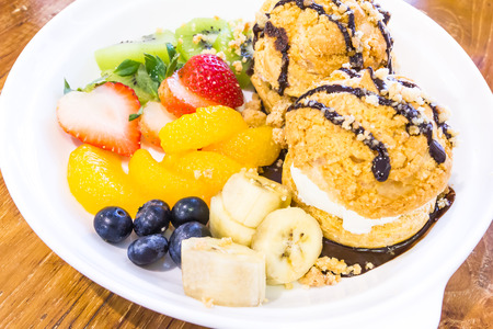 choux bun: ice cream with cookies and many fruits Stock Photo