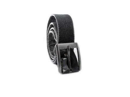 old black leather belt with buckle on white background