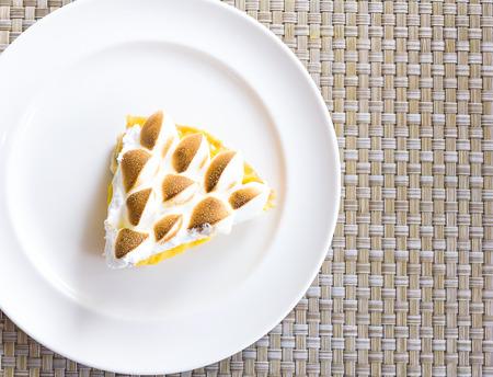 meringue cake on white plate Stock Photo