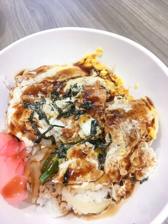 Deep fried breaded pork topped with egg on steamed rice. Katsudon