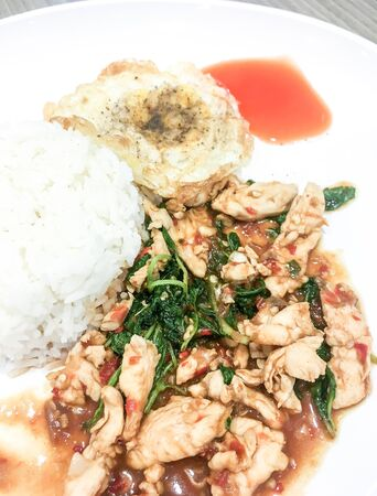 Basil Fried Chicken with rice and fried egg