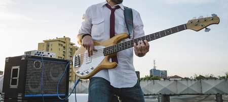 Bass player playing outdoors