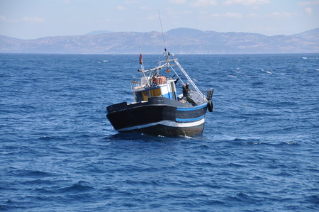 tarifa: Moroccan fishing boat in the Strait of Gibraltar out of Tarifa, Andalusia, Spain Stock Photo