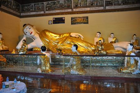 recline: Buddha statue at Shwedagon Pagoda, Yangon, Myanmar Editorial