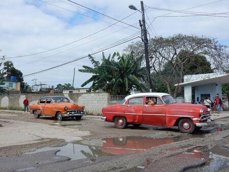 to paula: Classic American cars in San Francisco de Paula, Havana, Cuba