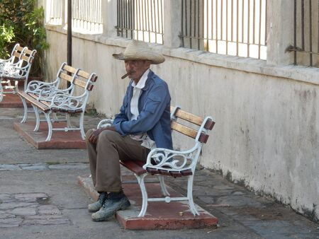 smoking a cigar: A man smoking a cigar in Vinales, Cuba