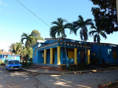 colonial building: Colonial building and a car in Vinales, Cuba