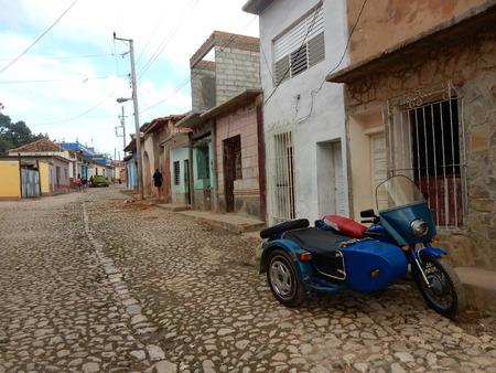 sidecar: A cobblestone street and a sidecar in Trinidad, Cuba