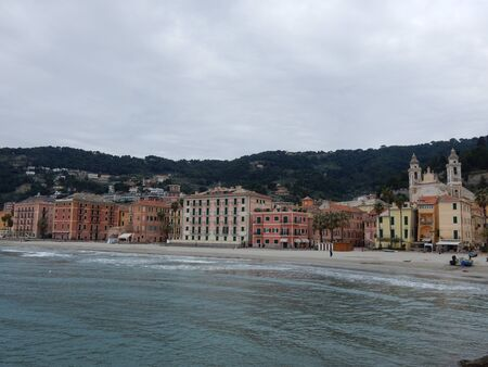 old  buildings: the beach and colorful old buildings in Laigueglia, Liguria, Savona Province, Italy