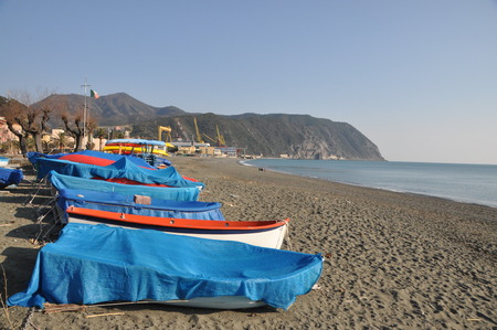 typical ligurian fishing boats, Gozzi, on the beach in Riva Trigoso, Italy Stock Photo