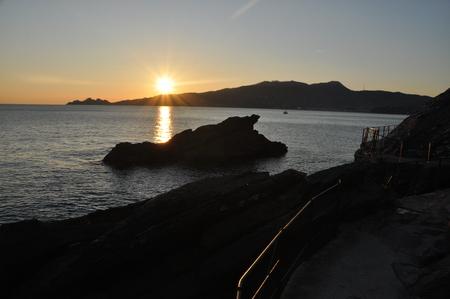 Sunset in Zoagli promenade with Tigullio gulf and Portofino in the background, Liguria, Italy