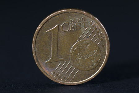 cent: One euro cent coin black background