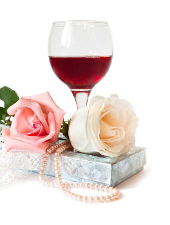 A romantic gift with two beautiful rose and pears on a white photo