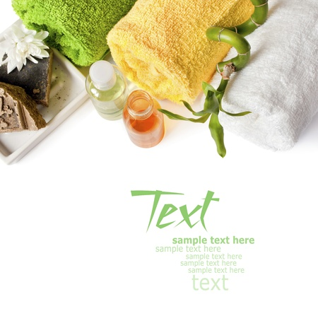 Spa background with towels, shampo, bamboo and soap isolated on a white photo