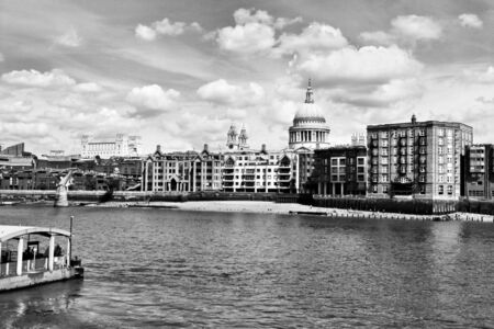 A view of St Pauls Cathedral across the River Thames showing the Millennium Bridge