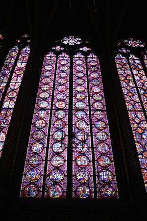 A view of the Stained Glass windows in Sainte Chapelle in Paris