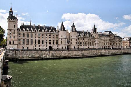 A view of the Conciergerie in Paris across the river Seine