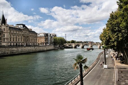 A view of the Conciergerie in Paris across the river Seine