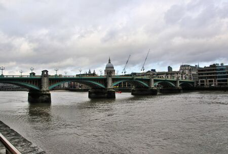 A view of St Pauls Cathedral across the river Thames Stock Photo
