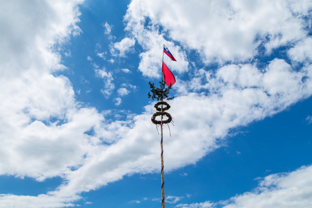 maypole: Maypole with Slovenian and Workers red Flag Stock Photo