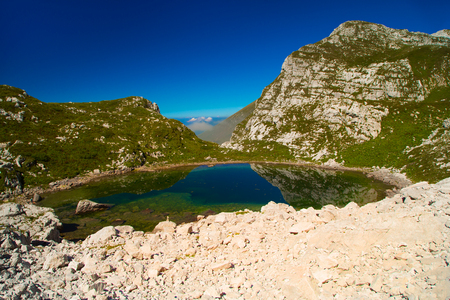 Glacial small lake Lužnica at Julian Alps, Krn,  Slovenia,