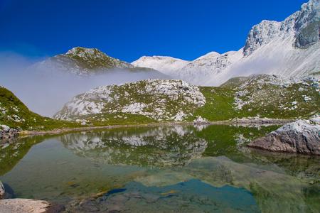 Glacial small lake Lužnica at Julian Alps, Krn,  Slovenia,