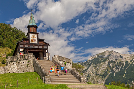 Tourists visiting the Memorial Church of the Holy Spirit at Polog, Slovenia Stock Photo
